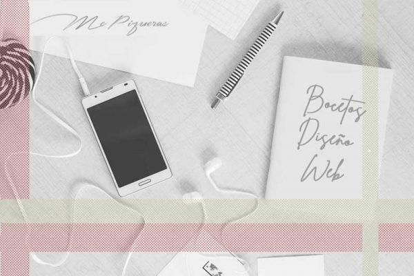 móvil con auriculares y boceto de diseño web
